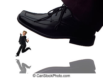 business concept - men shoe stepping on business women...