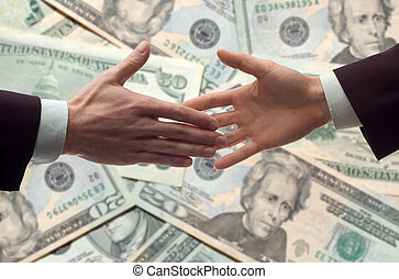 handshake - business handshake with money bills in...