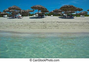 Tropical Paradise - Umbrellas on beautiful tropical beach in...