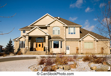 Dream home - A two-story brick luxury home with a rock...