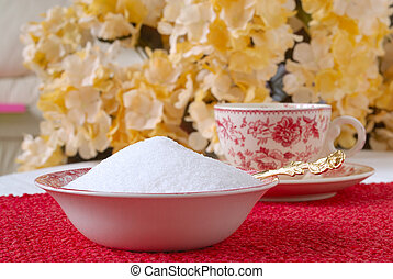 Granulated Natural Sugar in a Bowl on the Kitchen Table in...