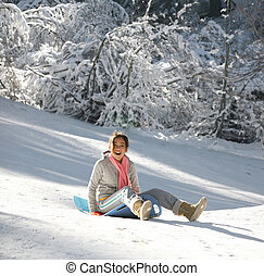 Girl on a sled - Teenage girl enjoying her sled ride