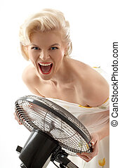 screaming housewife with fan playing pop star