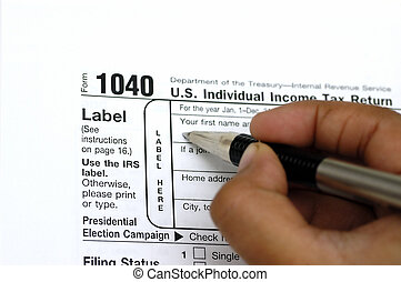 Tax Return - Filing a tax return. Pen and check book against...