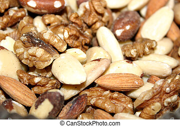 assorted fresh nuts ready shelled and in the dish