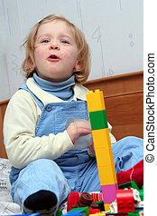 Playing with cube blocks - Little baby playing with colorful...