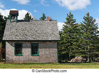 Old school house - Old fashioned school house with fire wood...