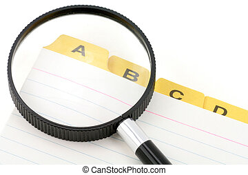 yellow file divider and magnifier, office supplies, close up