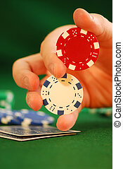 Twirl - Close up on man\\\'s hand doing a poker chip trick...