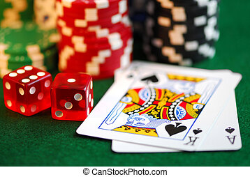 Gambling - Stacks of gambling chips, playing cards and dice...