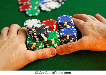 "All in - Poker player going ""all in\"" pushing his chips..."