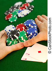 """All in - Poker player going \""""all in\"""" pushing his chips..."""