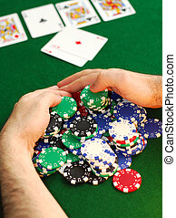 Big win - Poker player raking a big pile of chips