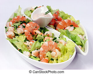 Salad - shrimp salad in a white exclusives plates with sauce