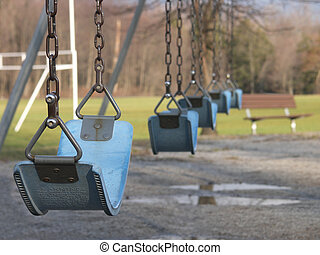 Empty swingset in a park.