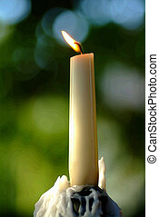 candle - a candle in front of a blurry background