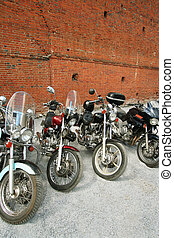 four motorcycles - Four motorcycles on a background of a...