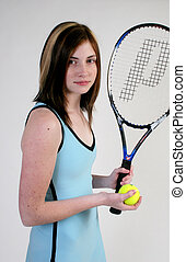 Woman tennis player - A woman is ready to play tennis with...