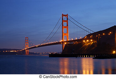 Golden Gate Glowing in the Dusk - Golden Gate Bridge is...