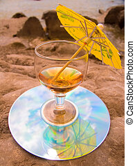 Glass with a wine cocktail on a beach