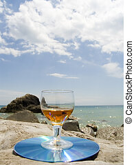 On a beach - Wine-glass with a drink on a sea beach...