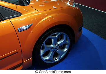 Orange car in a motorshow
