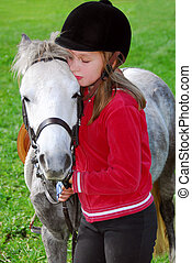 Girl and pony - Young girl with a white pony at countryside