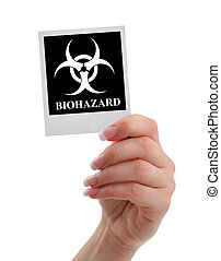 hand holding biohazard warning isolated on white