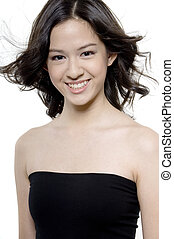 Pretty Teenage Girl - An attractive young woman with flyaway...