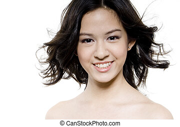 Flyaway Hair - A pretty young woman has her hair blown by a...