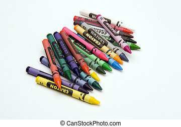 Multi coloured crayons against a plain background