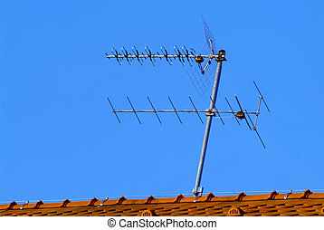 antenna - a white antenna on red brick roof