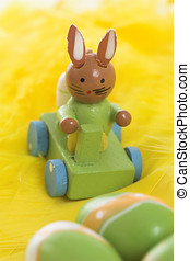 Little easter bunny decoration made of wood, positioned on...