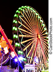 Fairground at Night - Fairground at night with bright lights...