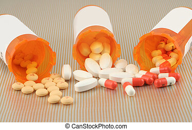 spilled pills - three different kinds of pills spilling out...