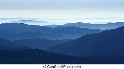 Mountains in the fog - View of far away blue mountains in...