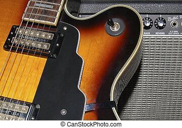 Guitar and amp - Closeup of classic archtop jazz guitar
