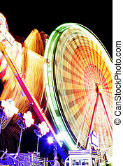 Fairground at Night - Night time motion blur with spinning...