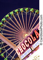 Fairground Scene - Ferris wheel with chocolate stand in the...