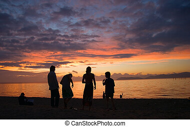 Sunrise Silhouette - Friends sihouetted by sunrise on Lake...