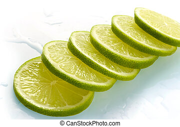 Lime cut on slices and laid out for preparation of cocktails...