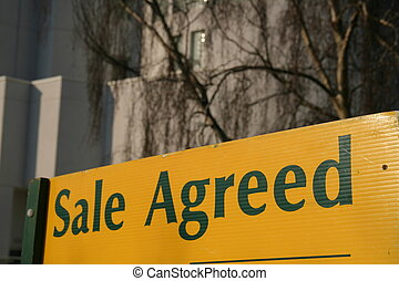 Sale Agreed sign in front of property