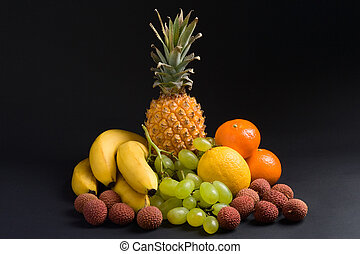 Fresh fruits - Various fresh fruits on a dark background