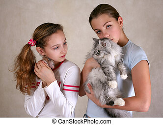 Two girlfriends - Two girls, one of them with a hamster,...