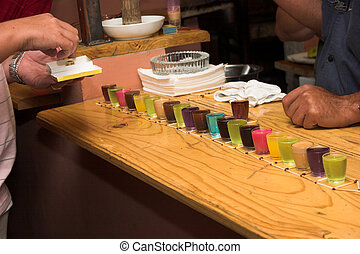 Drinking games in a bar with colourful shooters