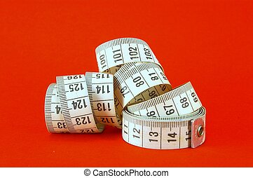Measuring Tape - Measuring tape on red background