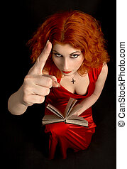 taboo - redhead religious lady with a book showing finger...
