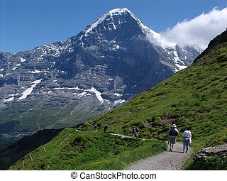 The Mighty Eiger - A view of some hikers hiking high in the...