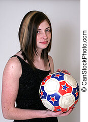 Woman and soccer - A woman with a soccer ball, bare arms and...