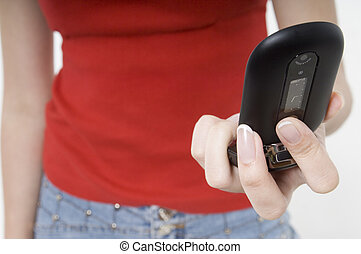 Mobile Phone - A young woman holding a modern mobile phone